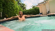 Busty Milf gets checked out and teases while swimming in the pool