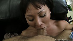 Short-haired slut chokes on a fat schlong before taking it deep
