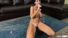 Busty babe Ava is oiled up and on the ground toying her slick slit