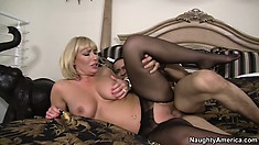 She lies by his side on the bed while his cock explores every inch of her pussy