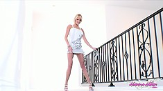 She does some posing with a white background holding the railing