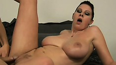 Attractive girl with huge boobs works a bulging monster sausage