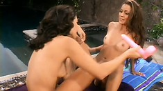 A trio of horny lesbian MILFs eat each other out by the pool