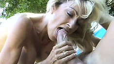 Stacked blonde cougar passionately blows and fucks a big cock outside