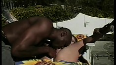 Dazzling blonde has a black dude punishing her tight pussy by the pool