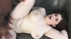 Chunky redhead babe with a stunning rack sucks on a big black boner