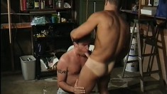Muscled stud has a guy sucking his big cock before he drills his ass
