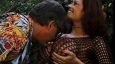 Curvy lady in a fishnet bodysuit Donita Dunes reveals her oral skills