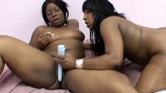 Curvaceous black lesbians please each other's pussies with sex toys