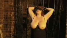 Big breasted bondage babe gets her titties punished by mistress
