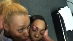 Naughty black girls sucking and stroking a big white shaft to orgasm