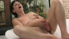 Horny housewife pleases herself with a dildo before fucking a young stud's cock