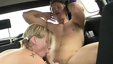 A bushy blonde cutie gets fucked in the back of a moving car