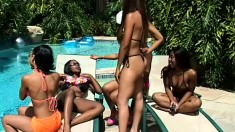 Four attractive babes explore each other's lesbian fantasies and desires by the pool