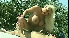 Lifeguard has a big breasted blonde sucking and fucking his big shaft