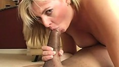 Blonde sex goddess stretches her cunt with a dildo before fucking