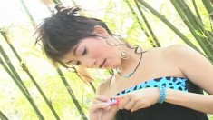 Pretty Asian girl Mind licks a lollipop and reveals her amazing body