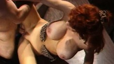 Trashy redhead with big boobs Bunny Bleu takes a long pole up her ass