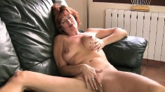 Alluring redhead milf with a hot ass Liddy pleases herself on the sofa