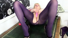 Amanda Degas is a busty grandma who toys in her purple nylons
