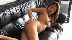 Stacked Oriental goddess Kat Naponya caresses her pussy on the couch
