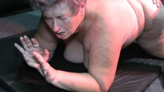Big fat granny is getting fucked from behind by a dude using a strapon