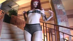 Horny redhead does a nice striptease and toy fucks her slick twat