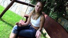 Dazzling blonde with a cute smile shares some of her secrets outside