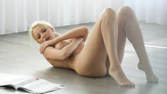 Enchanting blonde caresses her perfect tits and pleases her wet peach