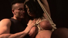 Busty Andrea is strung up and tortured in the dungeon getting nailed