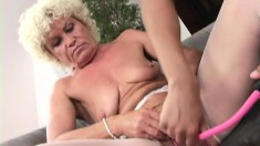 Slender blonde granny gets down on her knees to work an XXL dong