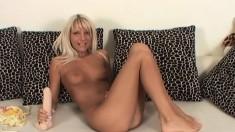 Jordan spreads her sexy legs and stuffs a huge dildo inside her twat