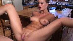 Slender housewife with big tits gets a dick up her ass in the kitchen