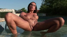 Buxom brunette has her fingers making her peach wet and happy outside