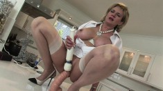Stacked blonde housewife loves to work her juicy cunt on a huge dildo
