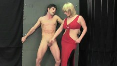 Seductive blonde in a sexy red dress pleases a big cock with her hands