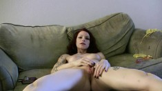 Sexy slim girl spreads her long legs and pleases her hot honey hole