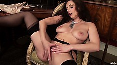 Naughty brunette chick in a black garter belt fingers her sex