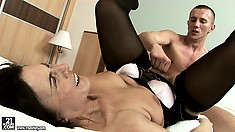 Naughty hoochie mama in stockings gets banged by a young cock