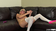 Mikki Lynn toys her tight ass and hot pussy at the same time on the couch