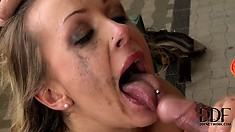 Her mascara runs down and stains her face as she chokes on a dick