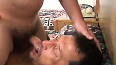 Two hot guys kiss each other and enjoy rough anal sex on the bed