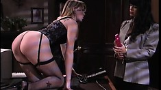 Busty blonde in sexy black lingerie gets her ass spanked hard by a lustful brunette