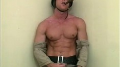 Muscled cop puts his great body on display and strokes his long dick