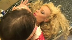 A filthy MILF with stupidly huge titties gets covered in cream