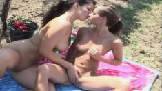 Young beauties Lena and Melisa fulfill each other's lesbian desires in the outdoors