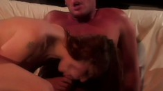 Sexy redheaded girl enjoys being fucked by her hunky young lover