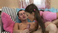 Young amateur brunette in pink shirt Sheena makes love in front of camera