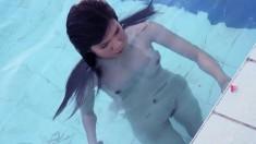Slim Oriental babe Angel Paroon sensually fingers her twat by the pool