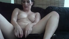 Busty babe Kitten spreads her legs and makes herself cum with a dildo